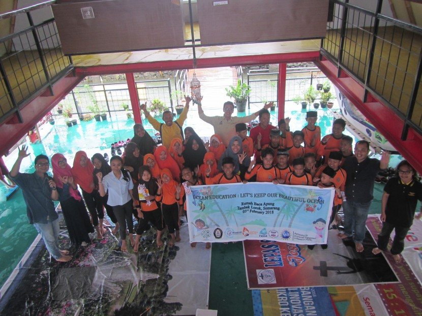 Figure 1.Group Photo with the children at Rumah Baca Apung, Tambaklorok, Semarang